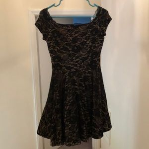 Girls dress. Juniors Black lace with nude lining.